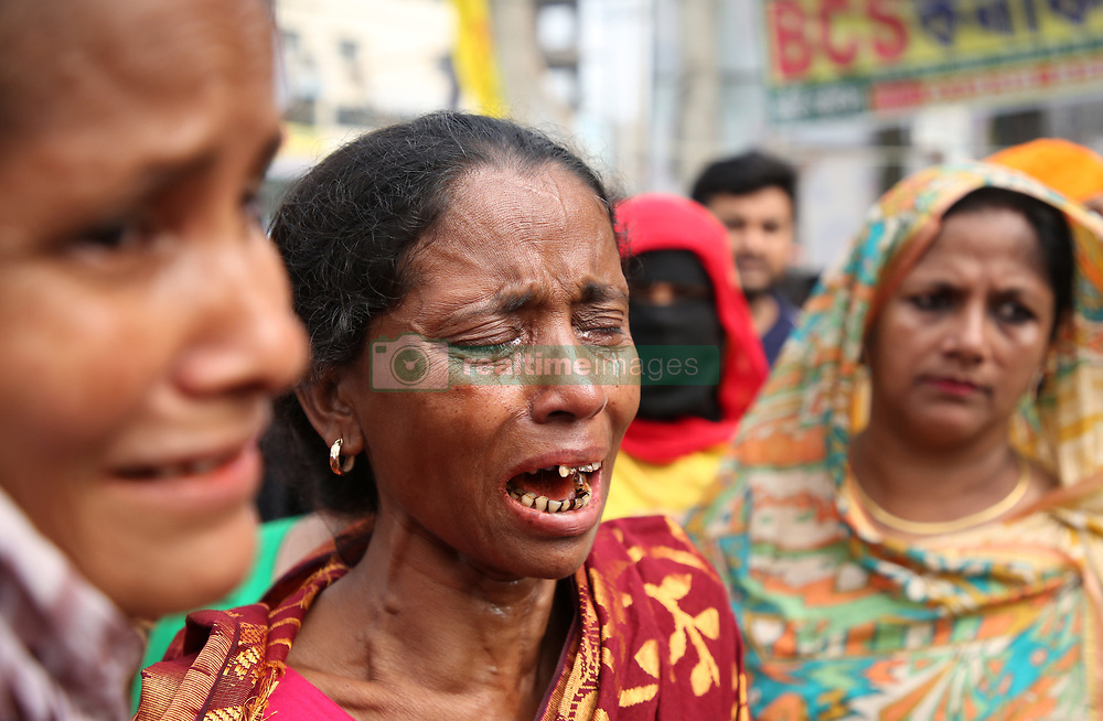 April 24, 2018 - Dhaka, Bangladesh - A relative of a victim killed in the Rana Plaza building collapse reacts as she and others mark the fifth anniversary of the disaster at the site where the building once stood in Savar in Dhaka, Bangladesh on April 24, 2018. The Rana plaza building collapsed was the world's worst garment factory disaster where more than 1,100 people killed in 2013. (Credit Image: © Sony Ramany/NurPhoto via ZUMA Press)