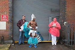 © Licensed to London News Pictures. 31/08/2015. London, UK. Members of the Paraiso School of Samba get ready for their parade. Torrential rain and persistant downpours didn't dampen the spirit of performers and revellers at the Notting Hill Carnival. Photo credit : Bettina Strenske/LNP