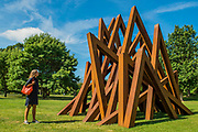 Bernar Venet, 11 Acute Unequal Angles (2016) - The Frieze Sculpture Park 2017 comprises large-scale works, set in the English Gardens . The installations will remain on view until 8 Oct 2017.