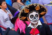 A young child dressed as a skeleton during the Day of the Dead Festival known in spanish as Día de Muertos on October 25, 2014 in Oaxaca, Mexico.