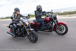 Iron Lilly Leticia Cline on a new 2017 Harley-Davidson 750 Street Rod alongside custom bike builder Jesse Rooke on a 2017 Harley-Davidson Road King Special as they ride A1A near Flagler Beach during Daytona Beach Bike Week. FL. USA. Tuesday, March 14, 2017. Photography ©2017 Michael Lichter.
