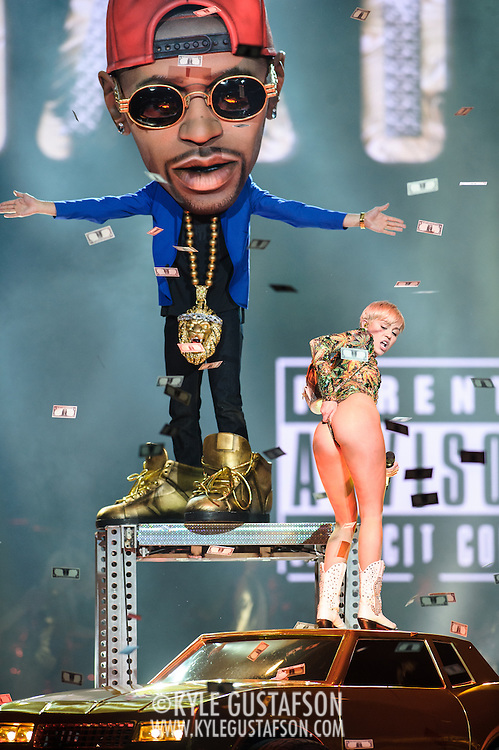 """WASHINGTON, DC - April 10th, 2014 - Miley Cyrus performs with a life-sized puppet of Big Sean as she sings """"Love Money Party"""" at the Verizon Center in Washington, D.C. as part of her Bangerz Tour. (Photo by Kyle Gustafson / For The Washington Post)"""