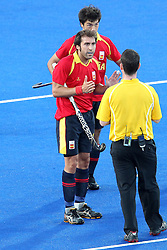 Alex Fabregas of Spain questions the referee during Pool MA Hockey  match between South Africa and Spain held at the Riverbank Arena in Olympic Park in London as part of the London 2012 Olympics on the 3rd August 2012..Photo by Ron Gaunt/SPORTZPICS
