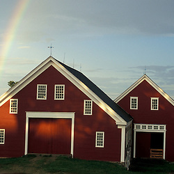 New Gloucester, ME..A rainbow rises from behind the barn at the Sabbathday Lake Shaker Village.