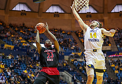 Dec 22, 2018; Morgantown, WV, USA; West Virginia Mountaineers forward Esa Ahmad (23) shoots in the lane while defended by West Virginia Mountaineers guard Chase Harler (14) during the first half at WVU Coliseum. Mandatory Credit: Ben Queen-USA TODAY Sports