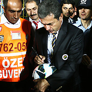 Fenerbahce's head coach Aykut Kocaman is signing the ball during their Turkish Super Cup 2012 soccer derby match Galatasaray between Fenerbahce at the Kazim Karabekir stadium in Erzurum Turkey on Sunday, 12 August 2012. Photo by TURKPIX