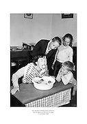 The Stephens children from Glasnevin bobbing for apples on Hallowe'en night.<br />