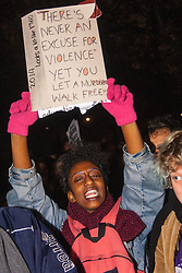 London, November 26th 2014. A vigil for teenager Mike Brown who was shot dead by a policeman in Ferguson, Missouri this year, takes place outside the US embassy in London. Anti-racism and human rights campaigners called the 'emergency' protest following a court verdict that clears Police Officer Darren Wilson of murder. PICTURED: A woman chants anti-racism slogans during the protest.