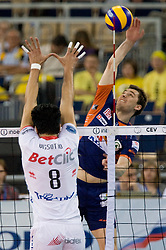 Andrej Flajs of ACH vs Neves Leandro Vissotto of Trentino at 2nd Semifinal match of CEV Indesit Champions League FINAL FOUR tournament between ACH Volley, Bled, SLO and Trentino BetClic Volley, ITA, on May 1, 2010, at Arena Atlas, Lodz, Poland. (Photo by Vid Ponikvar / Sportida)
