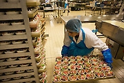A female employee prepares salads destined for airline meals by Gate Gourmet at Heathrow Airport. .