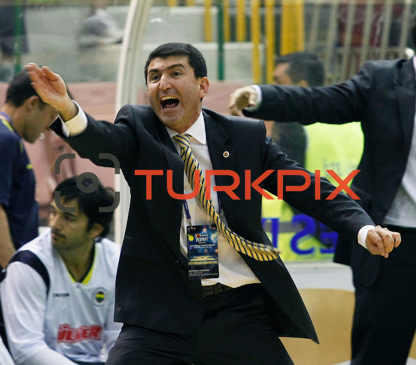 Fenerbahce Ulker's coach Ertuğrul ERDOĞAN during their Turkish Basketball league Play Off Final first leg match Efes Pilsen between Fenerbahce Ulker at the Ayhan Sahenk Arena in Istanbul Turkey on Thursday 20 May 2010. Photo by Aykut AKICI/TURKPIX