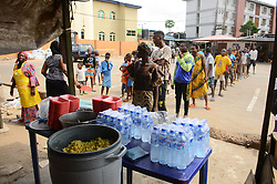 April 18, 2020, Lagos, Nigeria: People wait in line to collect food as Lagos state government begins distribution of meals to Youths in verious LCDAs, Local Community Development Areas as part of measures to prevent the spread of COVID-19 in Lagos, on April 18, 2020. Following the additional 14 days extension will afford the frontline health workers to ramp up contact identification, testing, and admission of suspected and confirmed cases in the state. (Credit Image: © Olukayode Jaiyeola/NurPhoto via ZUMA Press)