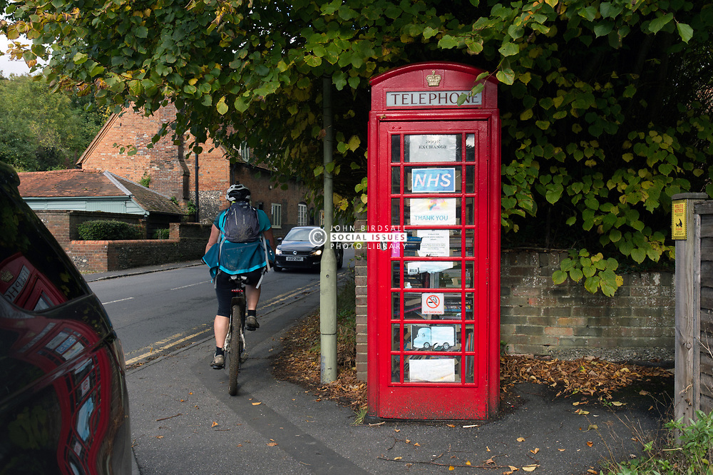 Repurposing a telephone booth as a book exchange and notice board. Streatley, UK. This is one of several around South Oxfordshire.  2020