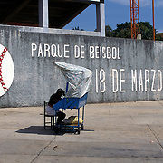MINATITLAN, MEXICO: A vendor waits for fans outside the baseball stadium in Minatitlan, Mexico where fans are few and far between.
