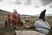 Unloading the yaks. Moving with the Khan (chief) family. The couple of Tella Bu and Daryo Boi family arrive from the Qyzyl Qorum camp to the summer camp of Kara Jylga, on the south side of the wide Little Pamir plateau...Trekking through the high altitude plateau of the Little Pamir mountains (average 4200 meters) , where the Afghan Kyrgyz community live all year, on the borders of China, Tajikistan and Pakistan.