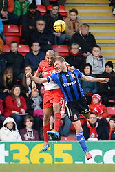 Orient's Elliot Omozusi and Swindon's Darren Ward compete for the ball - Photo mandatory by-line: Mitchell Gunn/JMP - Tel: Mobile: 07966 386802 22/02/2014 - SPORT - FOOTBALL - Brisbane Road - Leyton - Leyton Orient V Swindon Town - League One