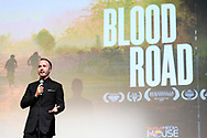 Nicholas Schrunk introduces the film at the screening of Blood Road at the Bluebird Theater in Denver, CO, USA on 27 June, 2017.