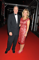 Chair of Battersea Dogs & Cats Homes Trustees HEATHER LOVE and her husband JONATHAN VINEHALL at the Battersea Dogs & Cats Home Collars & Coats Gala Ball held at Battersea Evolution, Battersea Park, London SW8 on 8th November 2012.