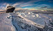 Marina Svetaeva, Ice-strengthened Russian cruise ship  in McMurdo Sound sea ice - volcano Mt Erebus behind- volcano, Ross Island.