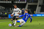 Cardiff City defender Joe Bennett (3) tackles Nathan Byrne of Derby County (12) during the EFL Sky Bet Championship match between Derby County and Cardiff City at the Pride Park, Derby, England on 28 October 2020.