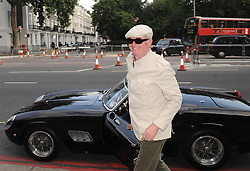 Chris Evans arrives in a classic Ferrari for the HarperCollins summer party at the Victoria and Albert Museum in south west London.