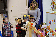 """Middletown, New York - A teacher guides students off the stage during the """"YMCA Thanksgiving Day Spectacular"""" in the gymnasium of the Center for Youth Programs on Nov. 27, 2013."""