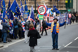© Licensed to London News Pictures. 15/01/2019. London, UK. Pro-Brexit and anti-Brexit demonstrators protest alongside each other outside the Houses of Parliament, Westminster. This evening, MPs are due to vote on British Prime Minister Theresa May's EU withdrawal deal, after the previous vote in December was postponed. Photo credit : Tom Nicholson/LNP