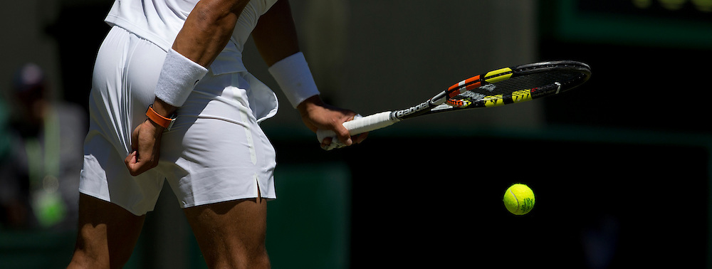Rafael Nadal (ESP) [10] in action during his victory over Thomaz Bellucci (BRA) in their Gentlemen's Singles First Round match today - Rafael Nadal (ESP) [10] def Thomaz Bellucci (BRA) 6-4 6-2 6-4<br /> <br /> Photographer Stephen White/CameraSport<br /> <br /> Tennis - Wimbledon Lawn Tennis Championships - Day 2 - Tuesday 30th June 2014 -  All England Lawn Tennis and Croquet Club - Wimbledon - London - England<br /> <br /> © CameraSport - 43 Linden Ave. Countesthorpe. Leicester. England. LE8 5PG - Tel: +44 (0) 116 277 4147 - admin@camerasport.com - www.camerasport.com.