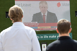 © Licensed to London News Pictures. 24/06/2016. London, UK. City workers near the London Stock Exchange watch Boris Johnson speak on a big screen for the first time after Britain's decision to leave the European Union. When markets opened this morning, the FTSE 100 dropped more than 8% in a low not seen since the financial crisis in 2012. Photo credit : Tom Nicholson/LNP