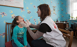 Paediatrician Dr Galina Piskunova examines 8-year-old Amina at the MSF mobile clinic set up 16 April 2015 in the town of Zorinsk near Lugansk.