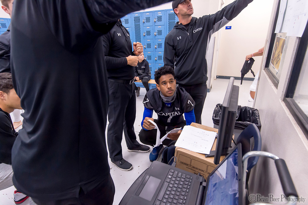 Capitol Christian Cougars Khalil Foyé (7), goes over plays in the locker room before the game as the Capitol Christian Cougars Varsity football team host the Bear River during the first round playoff game, Thursday Nov 9, 2017.<br /> photo by Brian Baer