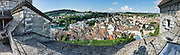 From the Munot fortress, admire a panorama of vineyards and Schaffhausen's Old Town, a patchwork of rooftops and spires, in Switzerland, Europe. The church steeples of Münster (first built 1064) and St Johann are respectively left and right. This image was stitched from multiple overlapping photos.
