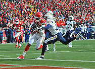 KANSAS CITY, MO - NOVEMBER 24:  Wide receiver Donnie Avery #17 of the Kansas City Chiefs scores a touchdown against defensive back Derek Cox #22 of the San Diego Chargers during the first half on November 24, 2013 at Arrowhead Stadium in Kansas City, Missouri.  (Photo by Peter Aiken/Getty Images) *** Local Caption *** Donnie Avery;Derek Cox
