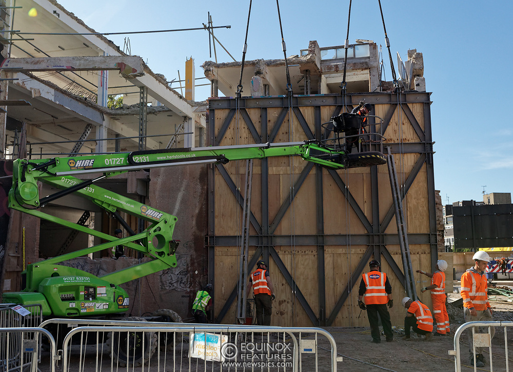 London, United Kingdom - 20 September 2019<br /> EXCLUSIVE SET - Aerial construction specialists and demolition experts use a huge crane to carefully lift intact, a twenty five ton, two-story wall, to preserve a famous Banksy rat image which has been covered up for years. Teams from specialist companies have spent over six weeks cutting around the artwork and fitting custom made eight ton steel supports to enable them to save the historic piece of art. Work has started on the construction of a new twenty seven floor art'otel hotel on the site of the old Foundry building in Shoreditch, east London, and a condition of the planning permission was to preserve the historical Banksy graffiti. A second section of the painting, an image of a TV being thrown through a broken window has already been cut out and moved separately. After the hotel construction is complete the two parts of the Banksy painting will be displayed on the hotel. Our pictures show the stages of work to protect the image, culminating in the lifting of the three story wall by crane. Video footage also available.<br /> (photo by: EQUINOXFEATURES.COM)<br /> Picture Data:<br /> Photographer: Equinox Features<br /> Copyright: ©2019 Equinox Licensing Ltd. +443700 780000<br /> Contact: Equinox Features<br /> Date Taken: 20190920<br /> Time Taken: 14150723<br /> www.newspics.com