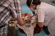 A young baby newly arrived from Syria recieves a medical examination after arriving in Turkey from the contested town of Kobani in northern Syria.