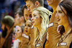Feb 2, 2019; Morgantown, WV, USA; A West Virginia Mountaineers cheerleader celebrates after beating the Oklahoma Sooners at WVU Coliseum. Mandatory Credit: Ben Queen-USA TODAY Sports