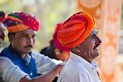 Traditional Rajasthani  musician on the 20th January 2018  in the village of Shilpgram, Udaipur, India. The individual villages each have their own distinctive turbans both in colours and the methods of tying.