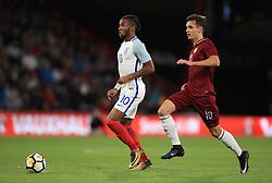 England's Kasey Palmer (left) battles for possession of the ball with Latvia's Vladislavs Fjodorovs
