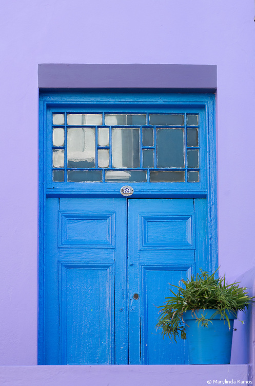 Blue doorway of a lilac-colored home in the Bo Kaap neighborhood of Cape Town, South Africa