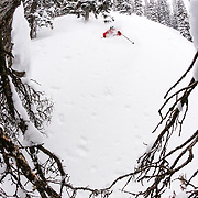 Andrew Whiteford skis powder during a winter storm cycle in the Tetons near Jackson, Wyoming.