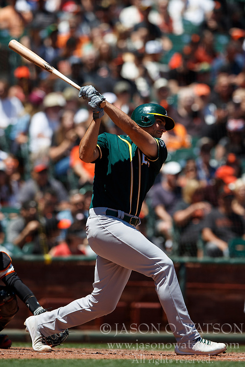 SAN FRANCISCO, CA - JULY 15: Matt Olson #28 of the Oakland Athletics hits an RBI single against the San Francisco Giants during the fourth inning at AT&T Park on July 15, 2018 in San Francisco, California. The Oakland Athletics defeated the San Francisco Giants 6-2. (Photo by Jason O. Watson/Getty Images) *** Local Caption *** Matt Olson