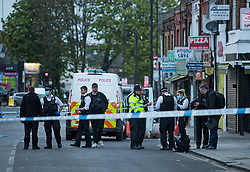 © Licensed to London News Pictures. 29/04/2021. London, UK. Emergency services at the scene at High Road in Willesden Green, North West London, where a man, reported to be in his 40s, has been stabbed to death at a bus stop. Photo credit: Ben Cawthra/LNP