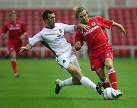 Fotball<br /> Foto: SBI/Digitalsport<br /> NORWAY ONLY<br /> <br /> Middlesbrough v Real Mallorca<br /> Pre-Season Football Friendly, Riverside Stadium, Middlesbrough 04/08/2004.<br /> Mallorca's Ivan Ramis (l) slides in to tackle Middlesbrough's Gaizka Mendieta (r).
