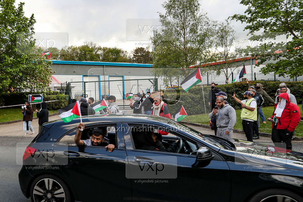 """Leicester, United Kingdom, May 19, 2021: People gathered to support UK based Pro-Palestinian activists group """"Palestine Action"""" who seized control of the Leicester based factory of Elbit subsidiary UAV Tactical Systems on Wednesday, May 19, 2021. Activists say that """"the occupation is aiming to be as disruptive as possible; these activists are determined to prevent Elbit from resuming its business of bloodshed."""" (Photo by Vudi Xhymshiti/VXP)"""