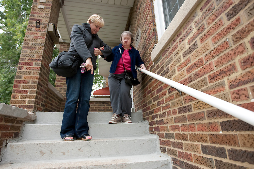 Mary Beth Solinski, a 59 year old, with Down Syndrome, is helped by her companion Tonia Kulig as she heads down the stairs...Aging adults with Down Syndrome. In 1983, people with Down syndrome could expect to live to age 25. Today, their life expectancy is 60 years. We interview a 59-year-old patient who has outlived her parents and is now in AARP. She has trouble walking, but has lots of interests, such as cooking, arts and crafts and reading.