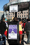 A play by play radio vendor sells radios that allow fans to listen to the game on Live Sports Radio as he wanders outside on the plaza level before the Baltimore Ravens NFL Super Bowl XLVII football game against the San Francisco 49ers on Sunday, Feb. 3, 2013 in New Orleans. The Ravens won the game 34-31. ©Paul Anthony Spinelli