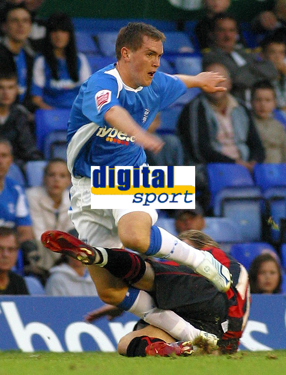 Photo: Dave Linney.<br />Birmingham City v Shrewsbury Town. Carling Cup. 22/08/2006.Birminghams Neil Kilkenny(Top) is brought down by Shrews defender  Michael Symes