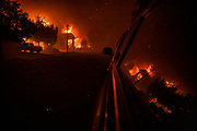 A home bursts into flames from the Shady Fire as it approaches Santa Rosa, CA on September 28, 2020. The wildfire quickly spread over the mountains and reached Santa Rosa where is has begun to affect homes.