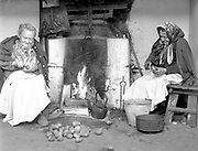 The Scoilean Cutters. Two country ladies from the mountains near Killarney  pictured cutting their scoileans (potatoes) in readiness for planting in 1982.<br /> Copyright  by Don MacMonagle  064-32833