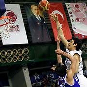 Anadolu Efes's Kerem Gonlum (R) during their Turkish Basketball League match Anadolu Efes between Turk Telekom at the Ayhan Sahenk Erdem Arena in Istanbul, Turkey on Sunday, 09 March, 2013. Photo by Aykut AKICI/TURKPIX
